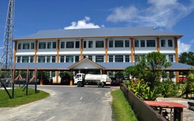 Water tanker filling up from roof run-off from the government building, Funafuti Atoll, Tuvalu