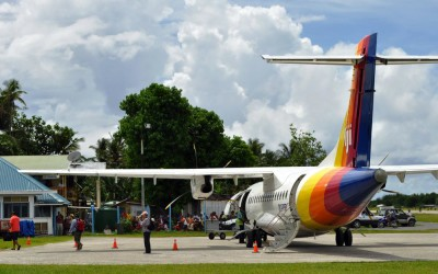 Passengers disembarking from the Air Pacific ATR42 from Suva, just arrived at Funafuti International Airport, Tuvalu