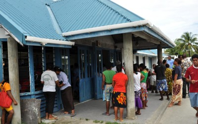 The crowd gathers around the terminal building, Funafuti International Airport, Tuvalu, to greet new arrivals on the flight which has just arrived from Suva