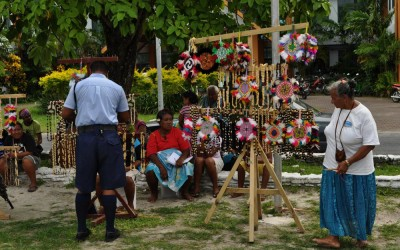 Tiny craft market springs up outside Funafuti International Airport, Tuvalu, on flight days.