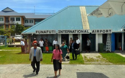 The (then) Tuvaluan Prime Minister walks out to the departing plane at Funafuti International Airport