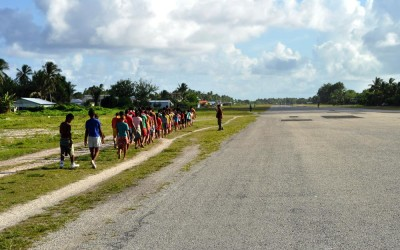 Sports training on the runway, Funafuti Atoll, Tuvalu