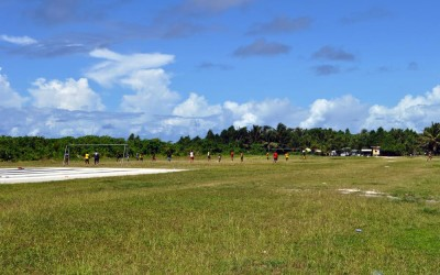 Sports match at the end of the runway, Funafuti Atoll, Tuvalu