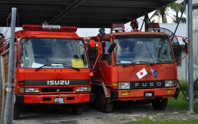 Fire trucks on Fongafale Island, Funafuti Atoll, Tuvalu. (One has apparently been donated by Japan.)