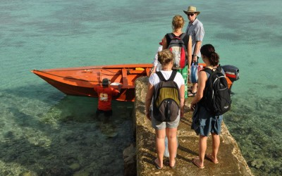 Getting into our boat for the ride out to Funafala, Funafuti Atoll, Tuvalu